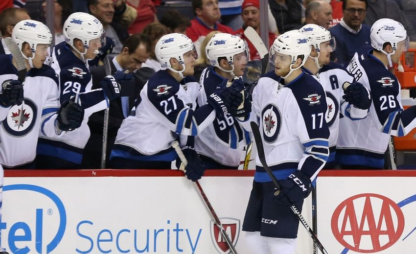 Nov 3, 2016; Washington, DC, USA; Winnipeg Jets center Adam Lowry (17) celebrates with teammates after scoring a goal against the Washington Capitals in the third period at Verizon Center. The Capitals won 4-3 in overtime. Mandatory Credit: Geoff Burke-USA TODAY Sports