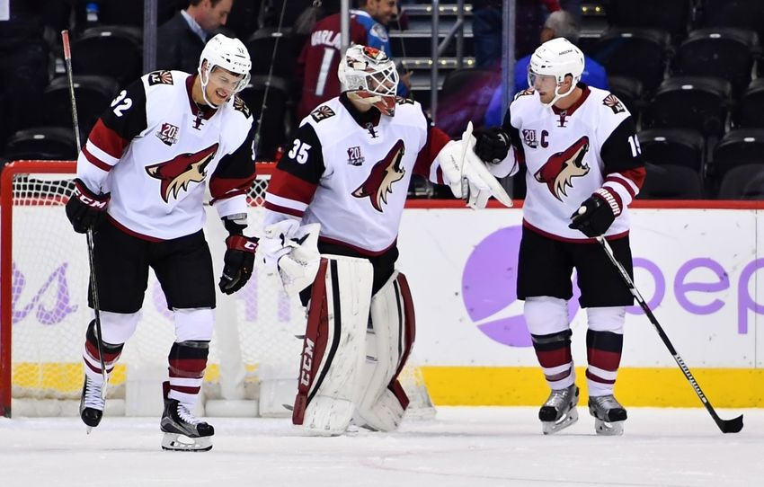 Nov 8, 2016; Denver, CO, USA; Arizona Coyotes goalie Louis Domingue (35) and center Tyler Gaudet (32) and right wing Shane Doan (19) celebrate the win over the Colorado Avalanche 4-2 at Pepsi Center. Mandatory Credit: Ron Chenoy-USA TODAY Sports