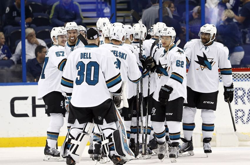 NHL Power Rankings: San Jose Sharks right wing Kevin Labanc (62) and teammates congratulate each other after they beat the Tampa Bay Lightning at Amalie Arena. San Jose Sharks defeated the Tampa Bay Lightning 3-1. Mandatory Credit: Kim Klement-USA TODAY Sports