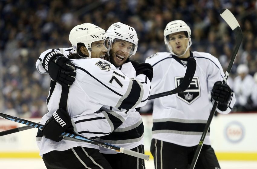 NHL Power Rankings: Los Angeles Kings defenseman Tom Gilbert (14) celebrates his goal with center Jordan Nolan (71) during the third period against the Winnipeg Jets at MTS Centre. Winnipeg wins in an overtime shootout 3-2. Mandatory Credit: Bruce Fedyck-USA TODAY Sports