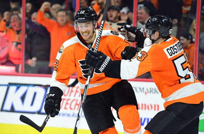 Nov 15, 2016; Philadelphia, PA, USA; Philadelphia Flyers left wing Michael Raffl (12) celebrates his goal with defenseman Shayne Gostisbehere (53) against the Ottawa Senators during the second period at Wells Fargo Center. Mandatory Credit: Eric Hartline-USA TODAY Sports