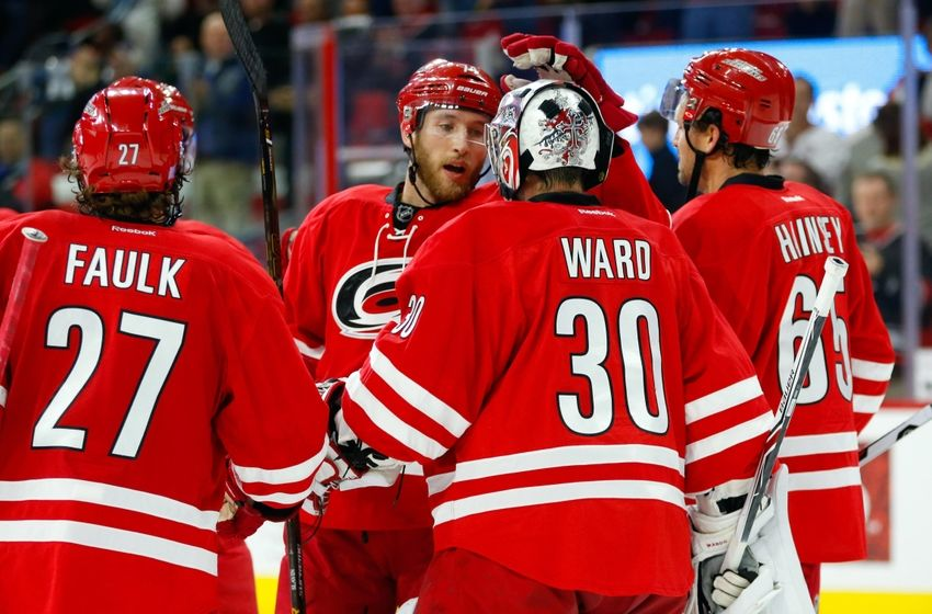 Nov 15, 2016; Raleigh, NC, USA; Carolina Hurricanes goalie Cam Ward (30) is congratulated by teammate defensemen Jaccob Slavin (74) after there victory against the San Jose Sharks at PNC Arena. The Carolina Hurricanes defeated the San Jose Sharks 1-0. Mandatory Credit: James Guillory-USA TODAY Sports