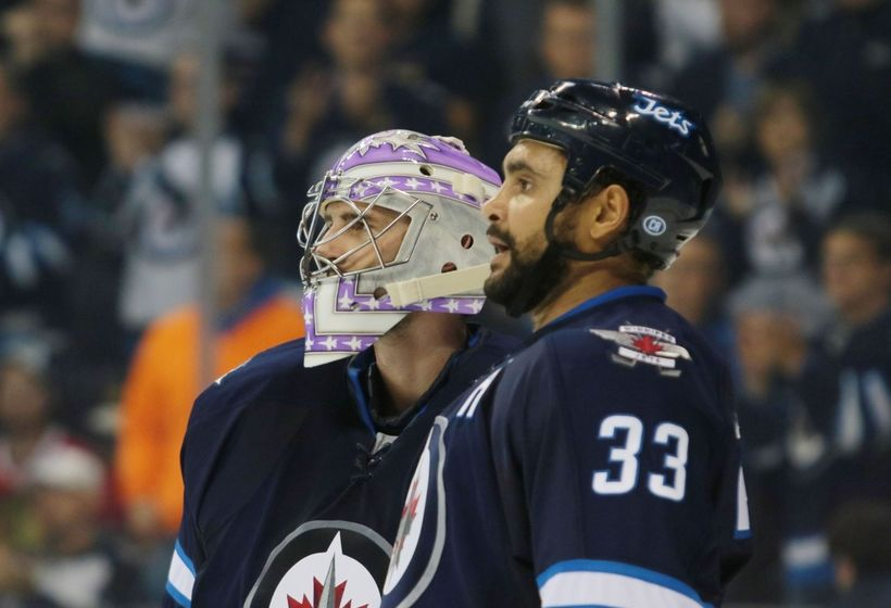 NHL Power Rankings: Winnipeg Jets goalie Connor Hellebuyck (37) celebrates his shutout and win over the Chicago Blackhawks after the third period at MTS Centre. Winnipeg won 4-0. Mandatory Credit: Bruce Fedyck-USA TODAY Sports