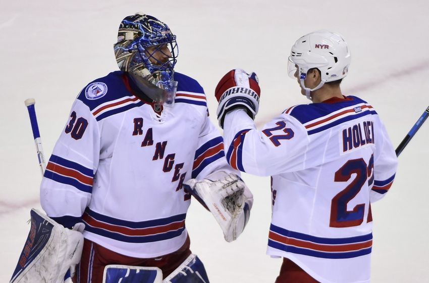 Nov 15, 2016; Vancouver, British Columbia, CAN; New York Rangers goaltender Antti Raanta (22) congratulates goaltender Henrik Lundqvist (30) for the win during the third period at Rogers Arena. The New York Rangers won 7-2. Mandatory Credit: Anne-Marie Sorvin-USA TODAY Sports