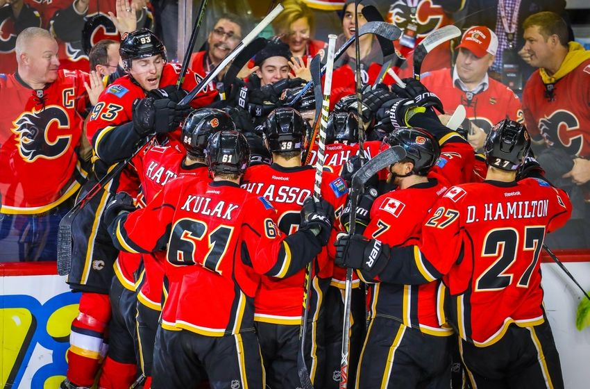 Nov 16, 2016; Calgary, Alberta, CAN; Calgary Flames right wing Michael Frolik (67) celebrates his goal with teammates against the Arizona Coyotes during the overtime period at Scotiabank Saddledome. Calgary Flames won 2-1. Mandatory Credit: Sergei Belski-USA TODAY Sports