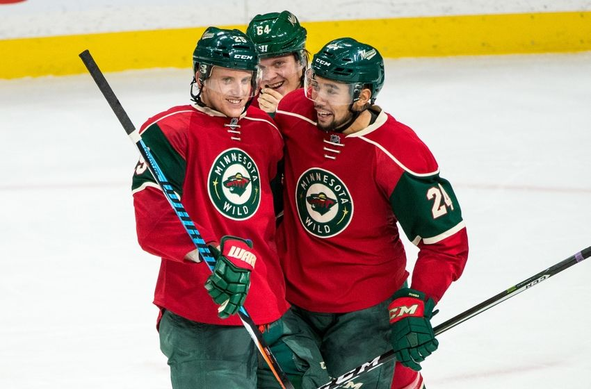 Nov 23, 2016; Saint Paul, MN, USA; Minnesota Wild defenseman Jonas Brodin (25) celebrates his goal with defenseman Matt Dumba (24) and forward Mikael Granlund (64) during the third period against the Winnipeg Jets at Xcel Energy Center. The Wild defeated the Jets 3-1. Mandatory Credit: Brace Hemmelgarn-USA TODAY Sports