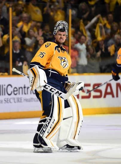 Apr 25, 2016; Nashville, TN, USA; Nashville Predators goalie Pekka Rinne (35) celebrates after a win against the Anaheim Ducks in game six of the first round of the 2016 Stanley Cup Playoffs at Bridgestone Arena. The Predators won 3-1. Mandatory Credit: Christopher Hanewinckel-USA TODAY Sports