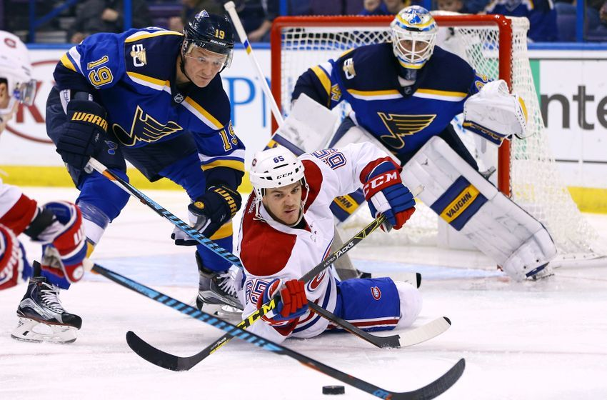 68ae14da0ab NHL Power Rankings  Montreal Canadiens center Andrew Shaw (65) reaches for  the puck as he falls to the ice and is pressured by St. Louis Blues  defenseman ...