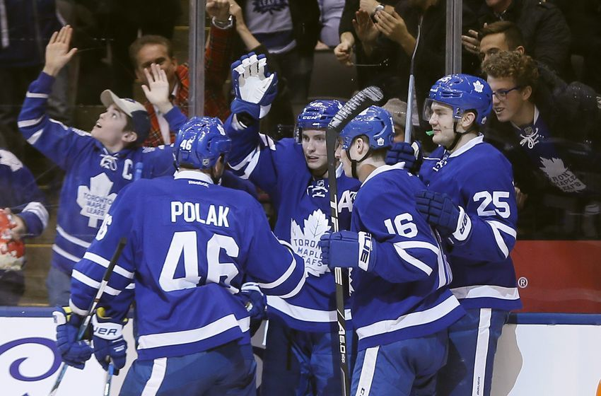 NHL Power Rankings: Toronto Maple Leafs forward Tyler Bozak (middle) celebrates his goal against the Minnesota Wild with Toronto Maple Leafs forward Mitchell Marner (16) and forward James van Riemsdyk (25) and defenseman Roman Polak (46) during the second period at Air Canada Centre. Mandatory Credit: John E. Sokolowski-USA TODAY Sports