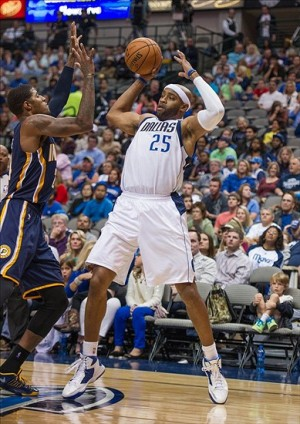 Oct 25, 2013; Dallas, TX, USA; Indiana Pacers shooting guard Paul George (24) guards Dallas Mavericks shooting guard Vince Carter (25) during the game at the American Airlines Center. The Pacers defeated the Mavericks 98-77. Mandatory Credit: Jerome Miron-USA TODAY Sports