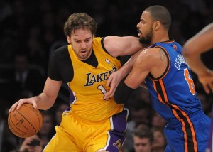 Dec 29, 2011; Los Angeles, CA, USA; Los Angeles Lakers forward Pau Gasol (16) is defended by New York Knicks center Tyson Chandler (6) at the Staples Center. Mandatory Credit: Kirby Lee/Image of Sport-USA TODAY Sports