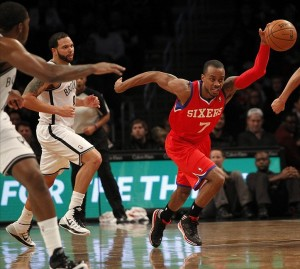 Dec 16, 2013; Brooklyn, NY, USA; Philadelphia 76ers point guard Lorenzo Brown (7) takes off on a fast break against the Brooklyn Nets during first half of NBA game at Barclays Center. Mandatory Credit: Noah K. Murray-USA TODAY Sports