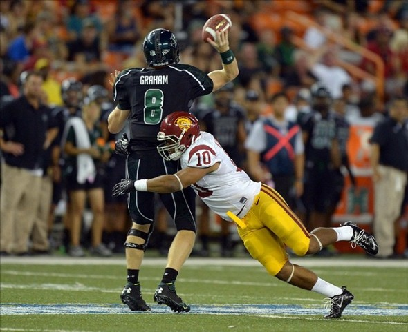 Aug 29, 2013; Honolulu, HI, USA; Southern California Trojans linebacker Hayes Pullard (10) pressures Hawaii Rainbow Warriors quarterback Taylor Graham (8) at Aloha Stadium. USC defeated Hawaii 30-13. Mandatory Credit: Kirby Lee-USA TODAY Sports