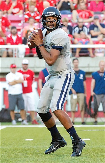 Aug 29, 2013; Salt Lake City, UT, USA; Utah State Aggies quarterback Chuckie Keeton (16) drops back to pass during the first half against the Utah Utes at Rice-Eccles Stadium. Mandatory Credit: Russ Isabella-USA TODAY Sports