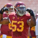 Sep 14, 2013; Los Angeles, CA, USA; USC Trojans linebacker Marquis Simmons (53) flexes before the game against the Boston College Eagles at Los Angeles Memorial Coliseum. Mandatory Credit: Robert Hanashiro-USA TODAY Sports
