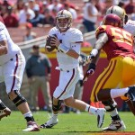 Sep 14, 2013; Los Angeles, CA, USA; Boston College Eagles quarterback Chase Rettig (11) rolls out as he looks for an open receiver during first quarter action against the USC Trojans at Los Angeles Memorial Coliseum. Mandatory Credit: Robert Hanashiro-USA TODAY Sports