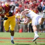 Sep 14, 2013; Los Angeles, CA, USA; USC Trojans running back Tre Madden (23) slips a tackle by Boston College Eagles defensive back Sean Sylvia on his way to a 16-yard gain at Los Angeles Memorial Coliseum. Mandatory Credit: Robert Hanashiro-USA TODAY Sports