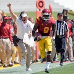 Sep 14, 2013; Los Angeles, CA, USA; USC Trojans wide receiver Marqise Lee (9) sprints down the sideline on his way to an 80-yard touchdown as he is trailed on the sidelines by head coach Lane Kiffin during the second quarter against the Boston College Eagles at Los Angeles Memorial Coliseum. Mandatory Credit: Robert Hanashiro-USA TODAY Sports