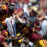 Sep 14, 2013; Los Angeles, CA, USA; Southern California Trojans linebackers Morgan Breslin (91) and Hayes Pullard (10) tackle Boston College Eagles tailback Dave Dudeck (26)at Los Angeles Memorial Coliseum. Mandatory Credit: Kirby Lee-USA TODAY Sports