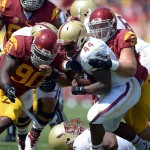 Sep 14, 2013; Los Angeles, CA, USA; Southern California Trojans linebacker Morgan Breslin (91) and defensive end George Uko (90) tackle Boston College Eagles tailback Andre Williams (44) at Los Angeles Memorial Coliseum. Mandatory Credit: Kirby Lee-USA TODAY Sports