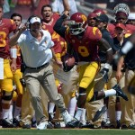 Sep 14, 2013; Los Angeles, CA, USA; Southern California Trojans receiver Marquise Lee (9) scores on an 80-yard touchdown reception as coach Lane Kiffin shouts encouragement in the second quarter against the Boston College Eagles at Los Angeles Memorial Coliseum. Mandatory Credit: Kirby Lee-USA TODAY Sports