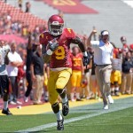 Sep 14, 2013; Los Angeles, CA, USA; USC Trojans wide receiver Marqise Lee (9) sprints down the sideline on his way to an 80-yard touchdown as he is trailed on the sidelines by head coach Lane Kiffin during the second quarter against Boston College at Los Angeles Memorial Coliseum. Mandatory Credit: Robert Hanashiro-USA TODAY Sports