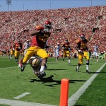 Sep 14, 2013; Los Angeles, CA, USA; USC Trojans running back Justin Davis (22) leaps over Boston College Eagles defensive back Dominique Williams (9) on his way to a fourth quarter touchdown at Los Angeles Memorial Coliseum. USC went on to win 35-7. Mandatory Credit: Robert Hanashiro-USA TODAY Sports