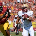 Sep 14, 2013; Los Angeles, CA, USA; Boston College Eagles running back Tyler Rouse (35) runs past USC linebacker Kevin Greene (81) on his way to a scoring a fourth quarter touchdown at Los Angeles Memorial Coliseum. Mandatory Credit: Robert Hanashiro-USA TODAY Sports