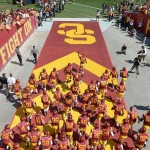 Sep 14, 2013; Los Angeles, CA, USA; Southern California Trojans linebacker Hayes Pullard (10) leads players onto the field before the game against the Boston College Eagles at Los Angeles Memorial Coliseum. USC defeated Boston College 35-7. Mandatory Credit: Kirby Lee-USA TODAY Sports