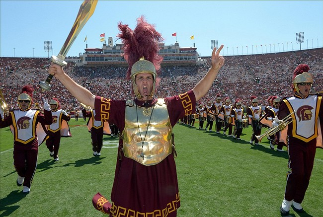 Sep 14, 2013; Los Angeles, CA, USA; Southern California Trojans mascot Tommy Trojan performs with the Spirit of Troy marching band during the game against the Boston College Eagles at Los Angeles Memorial Coliseum. USC defeated Boston College 35-7. Mandatory Credit: Kirby Lee-USA TODAY Sports