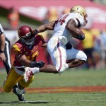 Sep 14, 2013; Los Angeles, CA, USA; Southern California Trojans linebacker Hayes Pullard (10) tackles Boston College Eagles tailback Andre Williams (44) at Los Angeles Memorial Coliseum. USC defeated Boston College 35-7. Mandatory Credit: Kirby Lee-USA TODAY Sports