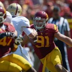Sep 14, 2013; Los Angeles, CA, USA; Southern California Trojans linebacker Morgan Breslin (91) pressures Boston College Eagles quarterback Chase Rettig (11) at Los Angeles Memorial Coliseum. USC defeated Boston College 35-7. Mandatory Credit: Kirby Lee-USA TODAY Sports
