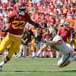 Sep 14, 2013; Los Angeles, CA, USA; USC Trojans running back Justin Davis (22) breaks a tackle by Boston College Eagles defensive back Sean Sylvia (19) on his way to a second half touchdown at Los Angeles Memorial Coliseum. Mandatory Credit: Robert Hanashiro-USA TODAY Sports