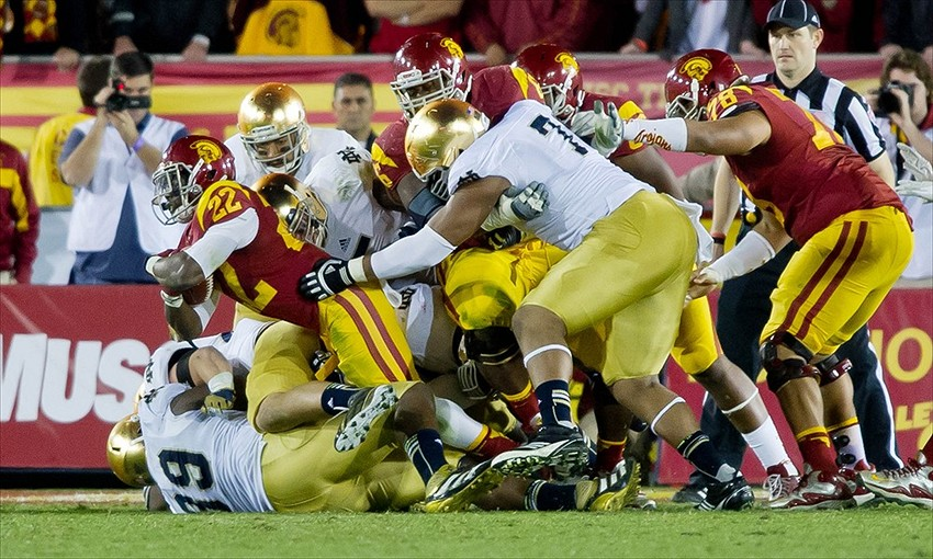 Nov. 24, 2012; Los Angeles, CA, USA; USC Trojans tailback Curtis McNeal (22) is tackled by Notre Dame Fighting Irish defensive end Kapron Lewis-Moore (89) and defensive end Stephon Tuitt (7) in the fourth quarter at the Los Angeles Memorial Coliseum. Notre Dame won 22-13. Mandatory Credit: Matt Cashore-USA TODAY Sports