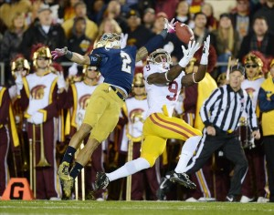 Oct 19, 2013; South Bend, IN, USA; Southern California Trojans receiver Marqise Lee (9) is defended by Notre Dame Fighting Irish cornerback Bennett Jackson (2) at Notre Dame Stadium. Mandatory Credit: Kirby Lee-USA TODAY Sports
