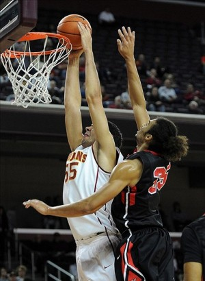 Nov 12, 2013; Los Angeles, CA, USA; USC Trojans center Omar Oraby (55) dunks past Cal State Northridge Matadors forward/center Tre Hale-Edmerson (35) in the first half of the game at The Galen Center. Mandatory Credit: Jayne Kamin-Oncea-USA TODAY Sports