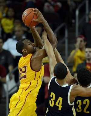 Nov 15, 2013; Los Angeles, CA, USA; Northern Arizona Lumberjacks forward Jordyn Martin (34) defends USC Trojans guard Byron Wesley (22) in the second half of the game at the Galen Center. Trojans won 67-63. Mandatory Credit: Jayne Kamin-Oncea-USA TODAY Sports
