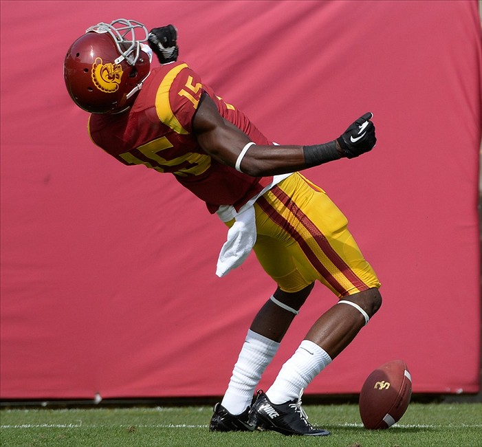 Oct 26, 2013; Los Angeles, CA, USA; USC Trojans wide receiver Nelson Agholor (15) celebrates scoring a first quarter touchdown against the Utah Utes at Los Angeles Memorial Coliseum. Mandatory Credit: Robert Hanashiro-USA TODAY Sports