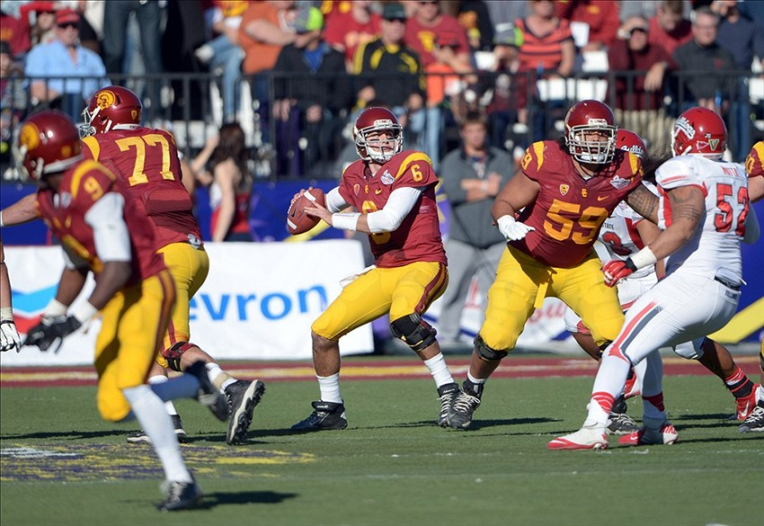 Dec 21, 2013; Las Vegas, NV, USA; Southern California Trojans quarterback Cody Kessler (6) throws a pass against the Fresno State Bulldogs in the Las Vegas Bowl at Sam Boyd Stadium. Mandatory Credit: Kirby Lee-USA TODAY Sports