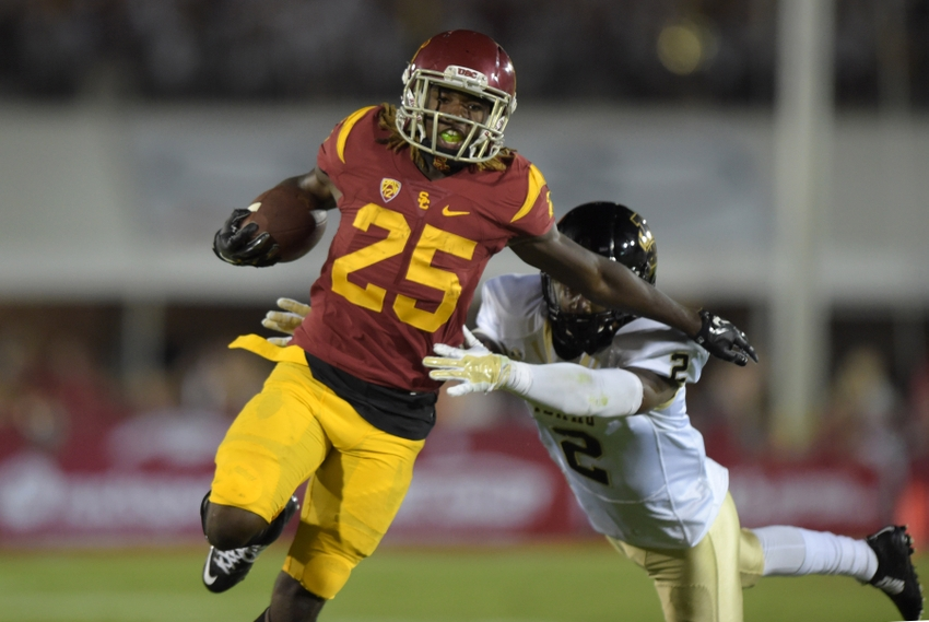 Sep 12, 2015; Los Angeles, CA, USA; Southern California Trojans tailback Ronald Jones (25) is pursued by Idaho Vandals cornerback D.J. Hampton (2) on a 44-yard gain the fourth quarter at Los Angeles Memorial Coliseum. Mandatory Credit: Kirby Lee-USA TODAY Sports