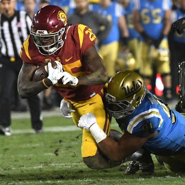 9692159-ncaa-football-southern-california-ucla-590x591