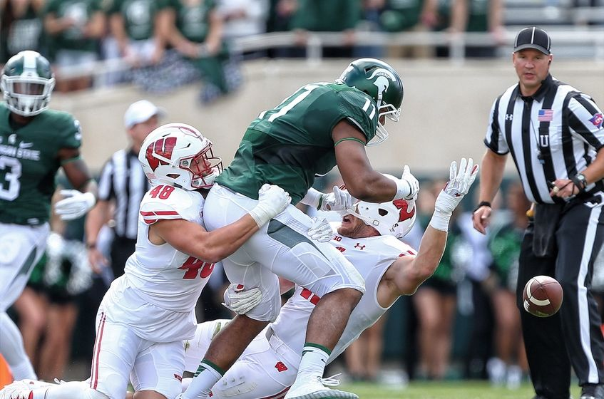 Sep 24, 2016; East Lansing, MI, USA; Michigan State Spartans tight end Jamal Lyles (11) has pass broken up by Wisconsin Badgers linebacker Jack Cichy (48) during the first quarter of a game at Spartan Stadium. Mandatory Credit: Mike Carter-USA TODAY Sports