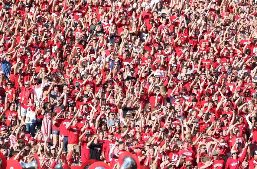 "Sep 10, 2016; Madison, WI, USA; Wisconsin Badger fans celebrate ""Jump Around"" before the start of the fourth quarter during the game against the Akron Zips at Camp Randall Stadium. Wisconsin defeated Akron 54-10. Mandatory Credit: Mary Langenfeld-USA TODAY Sports"
