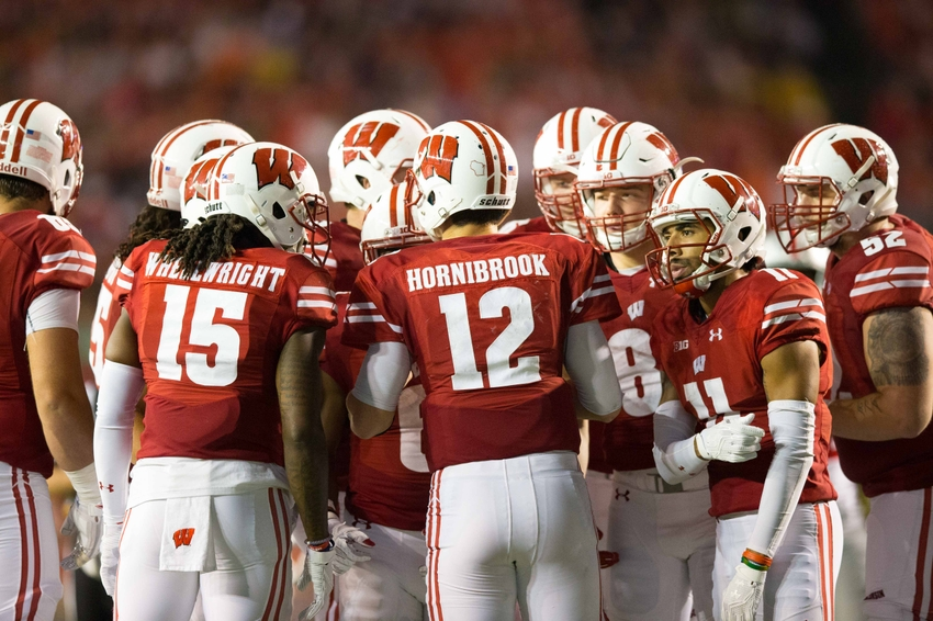 Oct 15, 2016; Madison, WI, USA; The Wisconsin Badgers offense huddles around quarterback Alex Hornibrook (12) during the game against the Ohio State Buckeyes at Camp Randall Stadium. Ohio State won 30-23. Mandatory Credit: Jeff Hanisch-USA TODAY Sports