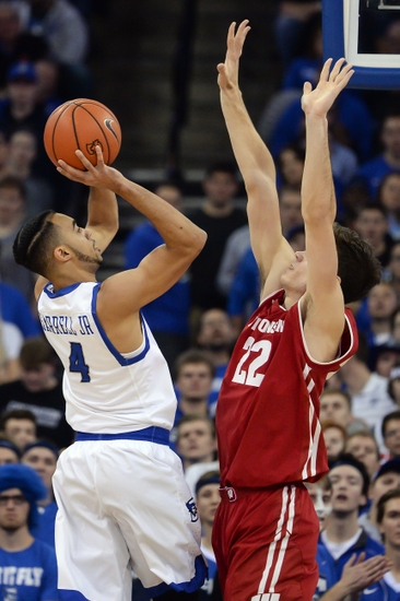 Nov 15, 2016; Omaha, NE, USA; Creighton Bluejays guard Ronnie Harrell Jr. (4) shoots over Wisconsin Badgers forward Ethan Happ (22) at CenturyLink Center Omaha. Mandatory Credit: Steven Branscombe-USA TODAY Sports