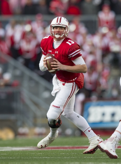 Nov 26, 2016; Madison, WI, USA; Wisconsin Badgers quarterback Bart Houston (13) drops back to pass during the second quarter against the Minnesota Golden Gophers at Camp Randall Stadium. Mandatory Credit: Jeff Hanisch-USA TODAY Sports