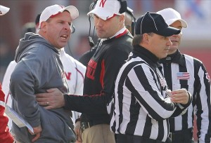 Nov 29, 2013; Lincoln, NE, USA; Nebraska Cornhuskers offensive coordinator Tim Beck moves head coach Bo Pelini away from the officials during the game against the Iowa Hawkeyes in the third quarter at Memorial Stadium. Pelini was called for unsportsmanlike conduct. Nebraska defensive coordinator John Papuchis, right, talks to the officials. Iowa won 38-17. Mandatory Credit: Bruce Thorson-USA TODAY Sports