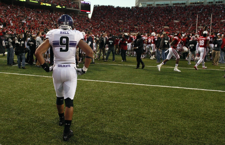 Nov 2, 2013; Lincoln, NE, USA; Northwestern Wildcats safety Jimmy Hall (9) watches Nebraska Cornhuskers celebrate after winning the game on the last play of the game at Memorial Stadium. Nebraska won 27-24. Mandatory Credit: Bruce Thorson-USA TODAY Sports