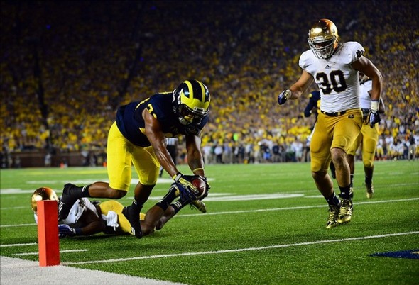 Sep 7, 2013; Ann Arbor, MI, USA; Michigan Wolverines wide receiver Jeremy Gallon (21) dives into the end zone for a touchdown during the third quarter against the Notre Dame Fighting Irish at Michigan Stadium. Mandatory Credit: Andrew Weber-USA TODAY Sports
