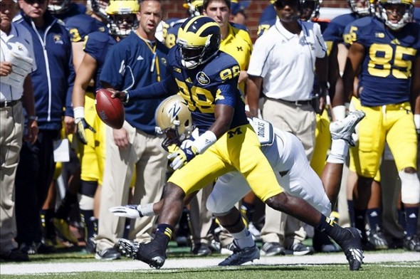 Sep 14, 2013; Ann Arbor, MI, USA; Michigan Wolverines quarterback Devin Gardner (98) runs the ball in the second quarter against the Akron Zips at Michigan Stadium. Mandatory Credit: Rick Osentoski-USA TODAY Sports